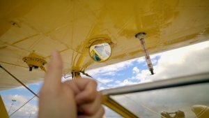 Soar high above the clouds in a vintage plane